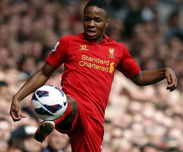 Liverpool's Raheem Sterling stretches for the ball during their English Premier League soccer match against Arsenal at Anfield in Liverpool