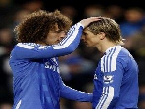 Chelsea's Luiz and team mate Torres pray before their English Premier League soccer match against Manchester United at Stamford Bridge in London